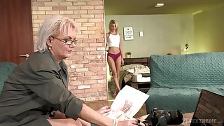 Sexy GILF photographer having carnal knowledge with a pretty young woman