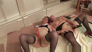 Twosome grandmas play with a cock & each successive